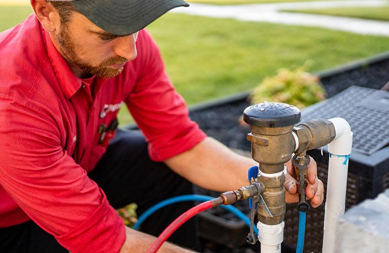 Technician Testing Sprinkler Backflow Device
